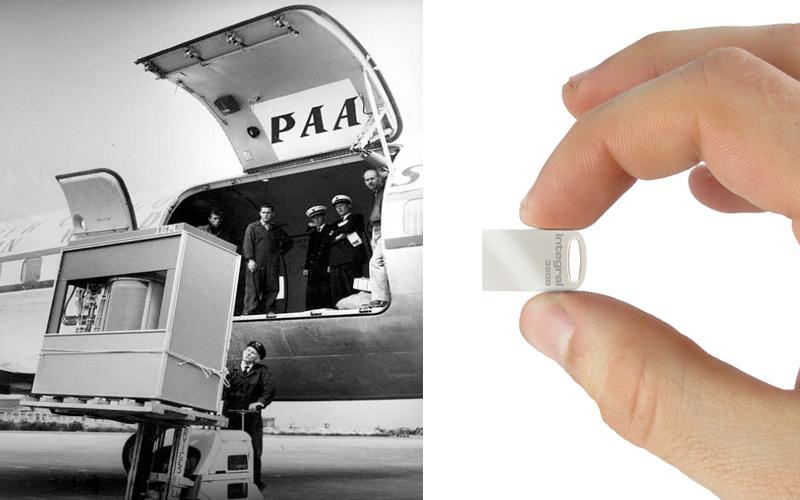 جهاز لحفظ 10 آلاف ميغا بايت لايزيد طوله عن عقدة اصبع (يميناً)، وفي اليسار طائرة ورافعة آلات ثقيلة وعدة أشخاص لحمل جهاز يخزن 5 ميغا بايت فقط. المصدر: سي دي ان تو