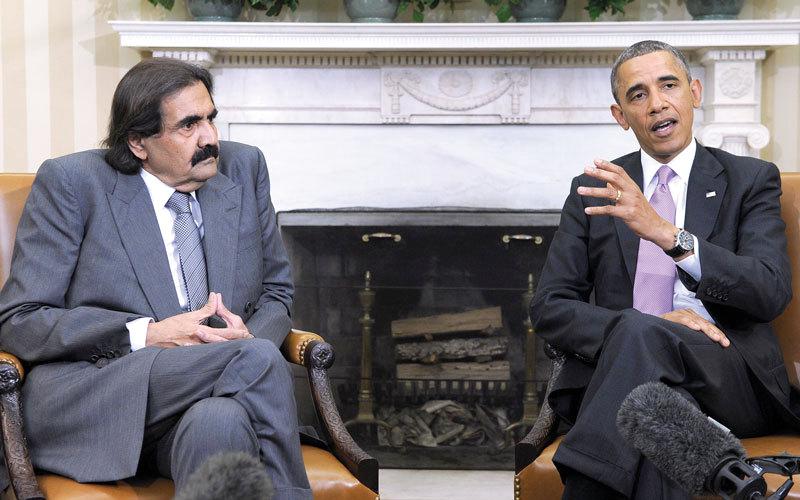 أوباما مع حمد بن خليفة.. علاقة غامضة عادت بالضرر على دول الخليج. أرشيفية