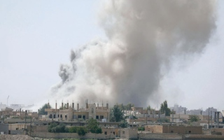 الصورة: تفجير انتحاري بمحطة حافلات في حماة السورية