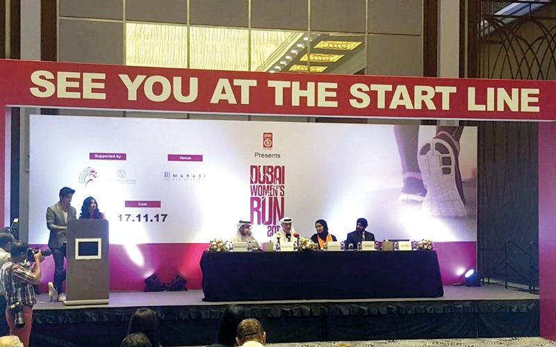 الصورة: بطلة جمباز تتقدم المشاركين في سباق دبي للجري