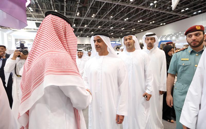 سيف بن زايد خلال زيارته جناح السعودية. من المصدر
