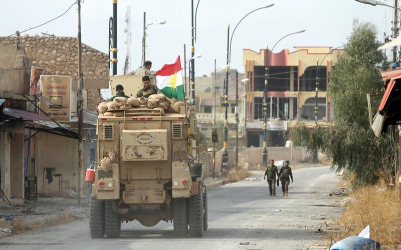 قوات البشمركة في الباشقة بعد أن طرد منها «داعش».  رويترز