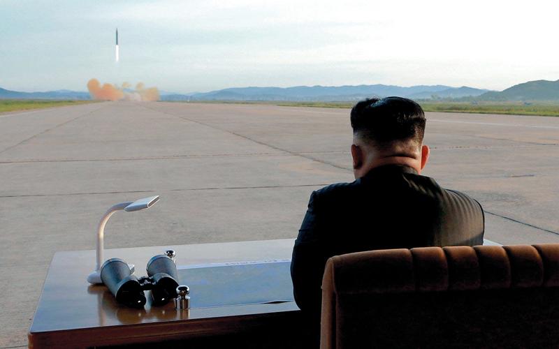 .. ويشاهد تجربة صاروخية. أ.ف.ب