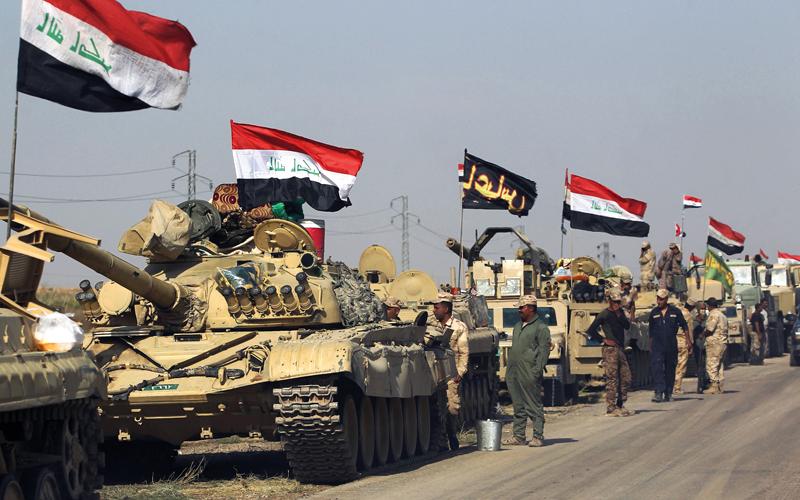 قوات الجيش العراقي متوقفة إلى جانب مواقع للبيشمركة. أ.ف.ب