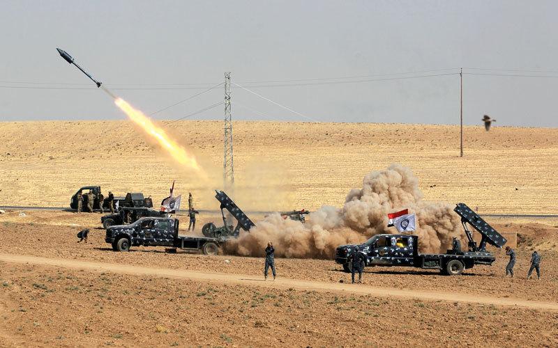 القوات العراقية تقصف مواقع البيشمركة.  أ.ف.ب