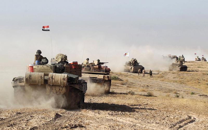 قوات عراقية مدعومة من الحشد الشعبي تتجه نحو تل عفر غرب الموصل.  أ.ف.ب