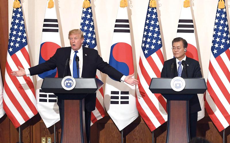 ترامب أكد لنظيره الكوري الجنوبي ضرورة ردع بيونغ يانغ. أرشيفية
