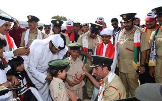 الصورة: شرطة دبي تحتفل باليوم الوطني في ظل علم طوله 500 متر