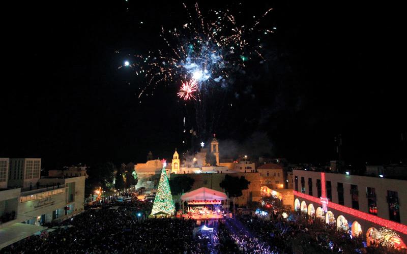 مسيحيو فلسطين يحيون أعياد ميلاد  «استثنائية» ويرفضون قرار ترامب