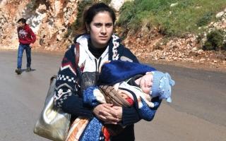 الصورة: 100 قتيل في قصف مقاتلات النظام وروسيا غوطة دمشق مع استـمرار نزوح المدنيين