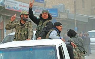 الصورة: قتلى باشتباك بين فصائل المعارضة السورية في عفرين