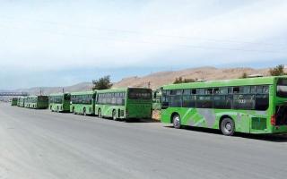 الصورة: اتفاق على إجلاء مقاتلين ومدنيين من دوما  في الغوطة الشرقية