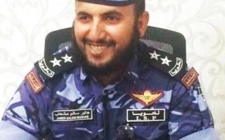الصورة: ضابط صاعقة قطري لقتيل «داعشي»: «تفخر بك الأمة»