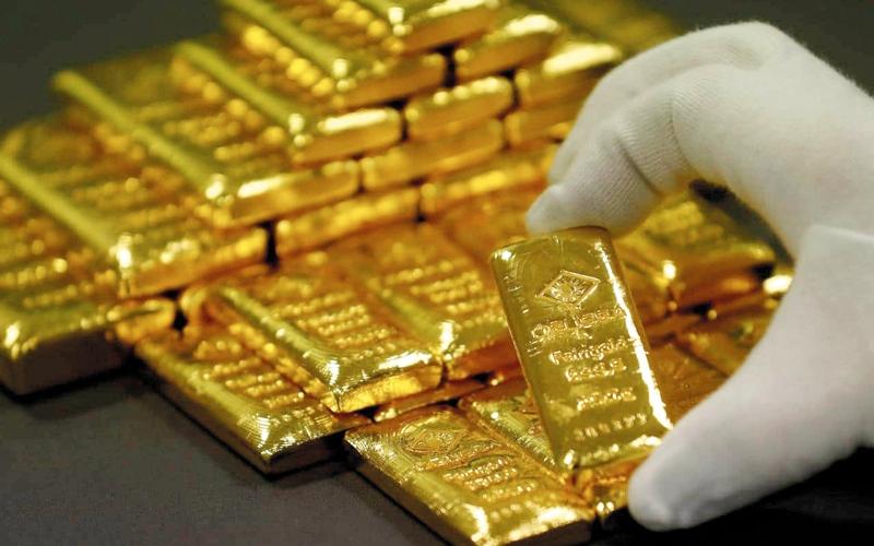 الصورة: انحسار التوترات العالمية وزيادة الفائدة الأميركية يدفعان الذهب للهبوط