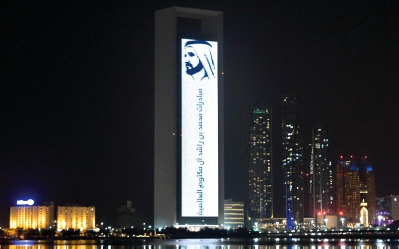 الصورة: أبوظبي تضيء مبانيها بشعار المبادرة الأكبر عربياً لصناعة الأمل