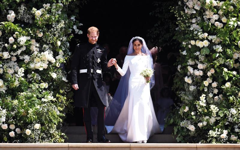 الصورة: الأمير هاري وماركل يتبادلان عهود الحب والخواتم
