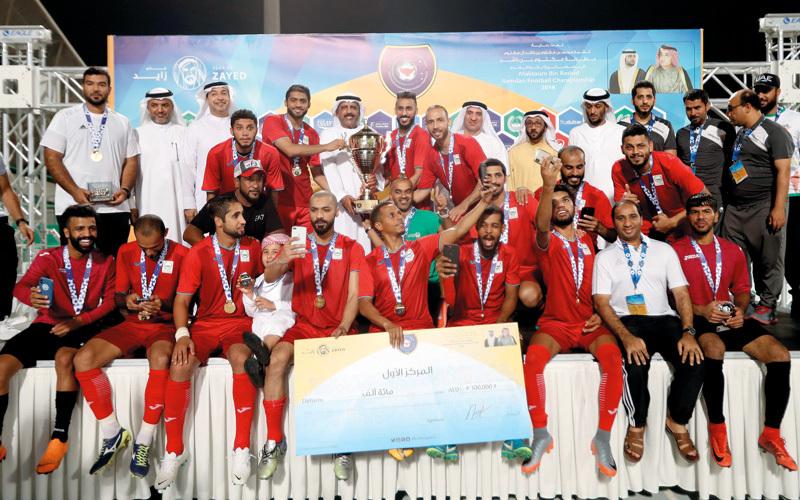 «شرطة دبي» يحتفل بالفوز. تصوير: أسامة أبوغانم
