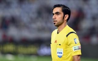 الصورة: محمد أحمد يوسف حكما خامسا في مباراة بولندا والسنغال