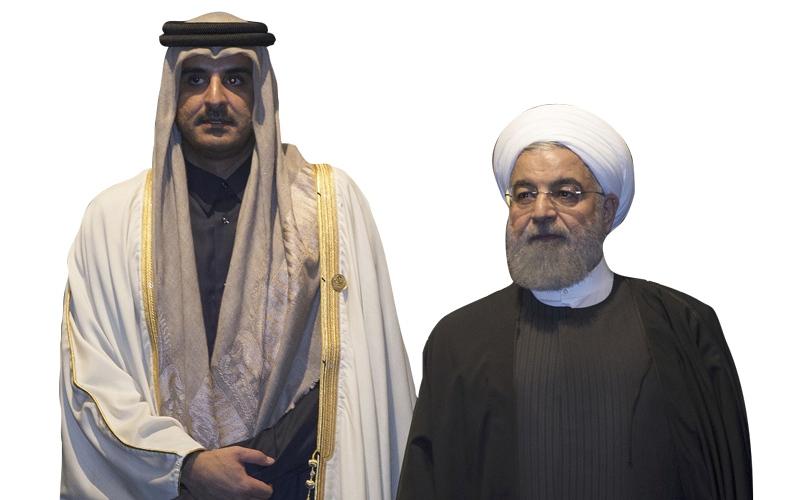 الصورة: تميم يتبادل الغزل السياسي مع روحاني ويعلن دعم إيران في اليمن