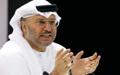 الصورة: قرقاش: قطر لم تحسب بدقة أضرار اتصال تميم وروحاني