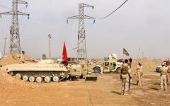 الصورة: العراق يشرع في إقامة سياج حدودي مع سورية