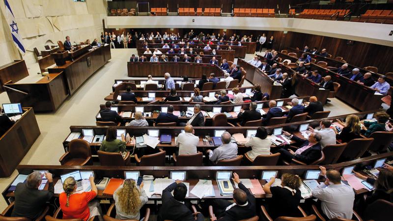 اجتماع الكنيست الإسرائيلي خلال موافقته على القانون العنصري. أ.ف.ب