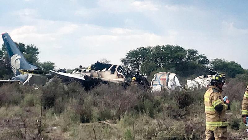 حطام الطائرة احترق بالكامل. أ.ف.ب