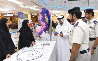 الصورة: شرطة أبوظبي تعزز التوعية المجتمعية في المراكز التجارية