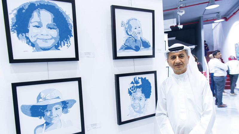 العوضي يشارك بـ4 أعمال في المعرض.  تصوير: أحمد عرديتي
