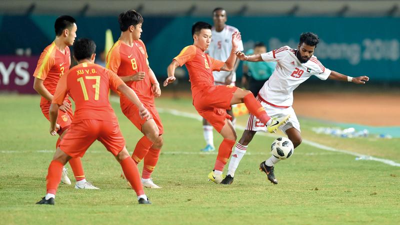 المنتخب الأولمبي تأهل إلى الدور الثاني بعناء في الدورة الآسيوية. من المصدر