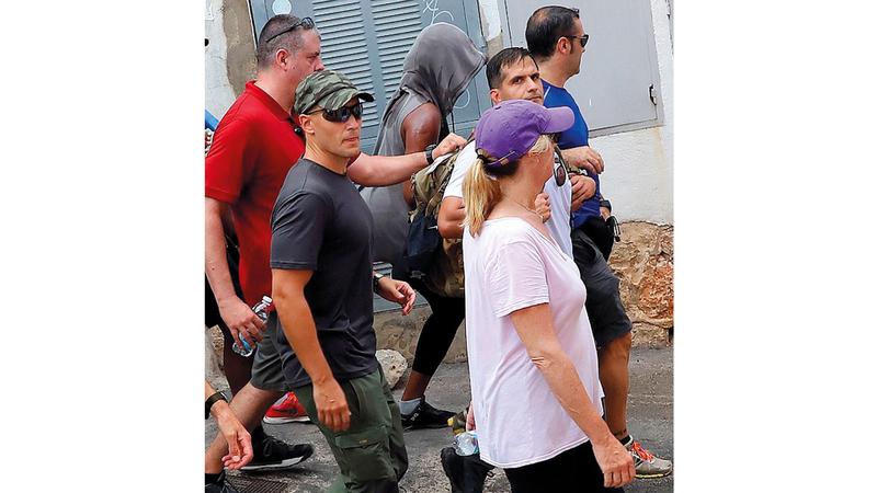 حراس يُحيطون بميشيل أوباما. غيتي