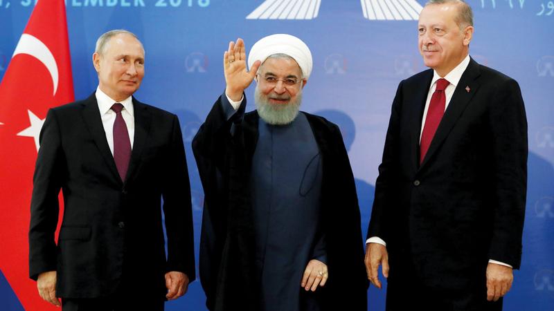 رؤساء روسيا وإيران وتركيا خلال اجتماعهم في طهران حول إدلب. إي.بي.إيه
