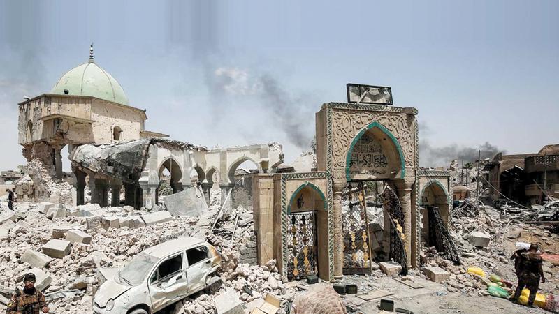 الجامع النوري ومنارته الحدباء من أبرز معالم الموصل التي دمرها تنظيم داعش الإرهابي. أرشيفية