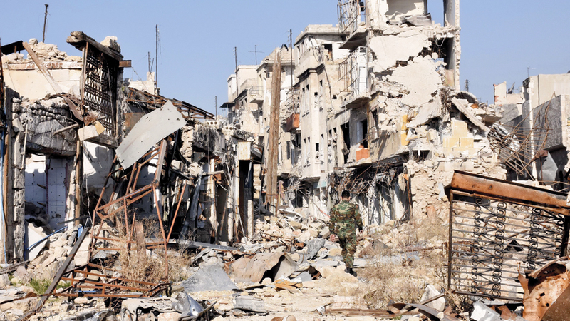 الغارات الجوية الروسية حولت أحياء شرق حلب إلى ركام وأجبرت مقاتلي المعارضة على الاستسلام.  أ.ف.ب