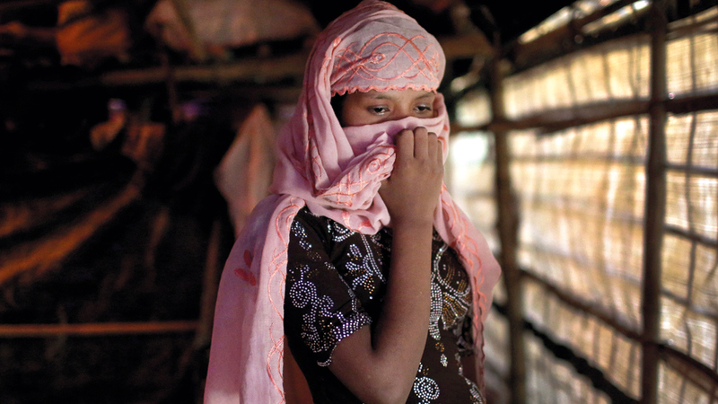 سيدة من الروهينغا تعرضت للاضطها على يد الجنود البورميين. ا.ب