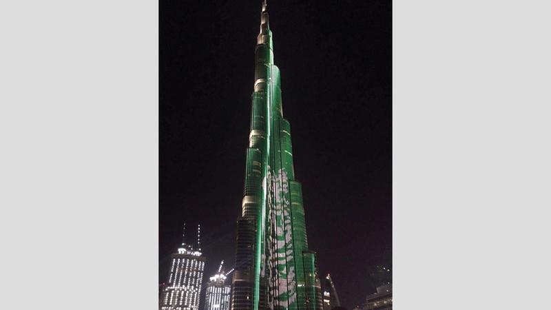 برج خليفة في دبي يتزيّن بعلم المملكة العربية السعودية في احتفالات سابقة.  أرشيفية