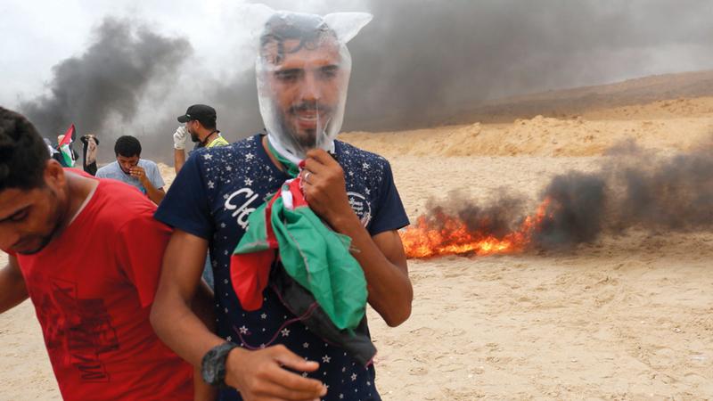 جانب من المواجهات مع قوات الاحتلال على حدود غزة.  أ.ف.ب