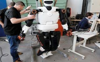 الصورة: عمّال بناء روبوتات.. يُشيّدون ناطحات السـحاب قريباً
