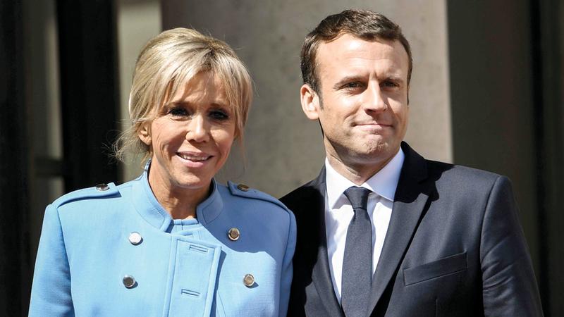 ماكرون وزوجته وعلاقة متوترة، غيتي
