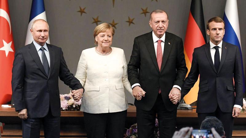 بوتين وماكرون وميركل وأردوغان ظهروا بمظهر القريب من وجهة نظر واشنطن لحل المشكلة السورية. أرشيفية