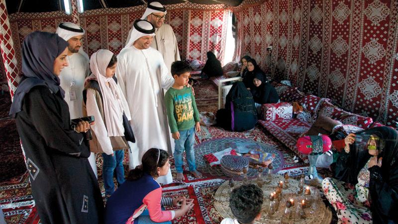 الشامسي والمرزوقي خلال فعاليات مخيم «البيت متوحد». من المصدر
