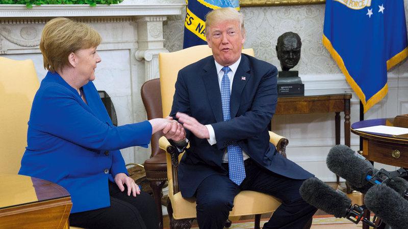 علاقة ترامب مع ميركل كانت متوترة دائماً. ي.ب.أ