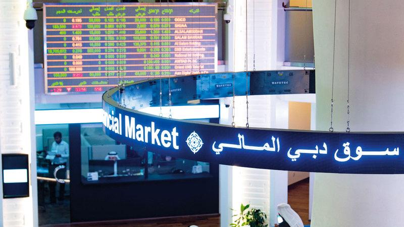 سوق دبي المالي واصل الارتفاع أمس. تصوير: أحمد عرديتي