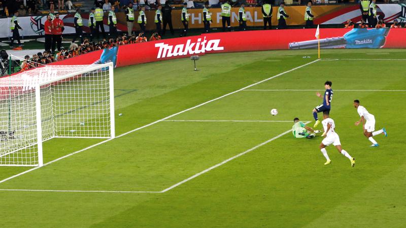 تاكومي مينامينو سجل هدف اليابان الوحيد في مرمى سعد الشيب. أ.ف.ب