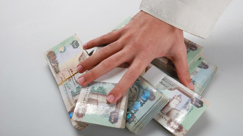 التوزيعات شملت 6.2 مليارات درهم أعلنتها 6 شركات في سوق دبي و11.7 مليار درهم أعلنتها 5 شركات في سوق أبوظبي. أرشيفية