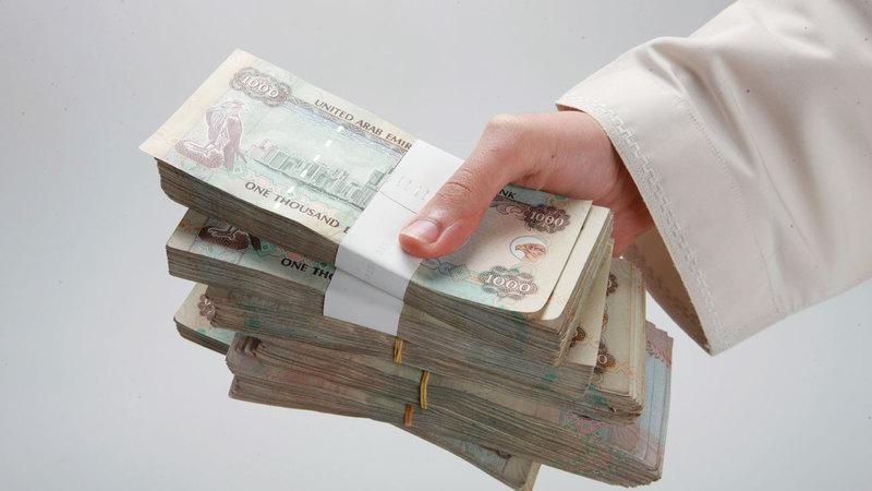 دفع أو تحصيل أي مبلغ فائدة أو توزيع أرباح يعتبر خدمة مالية. أرشيفية