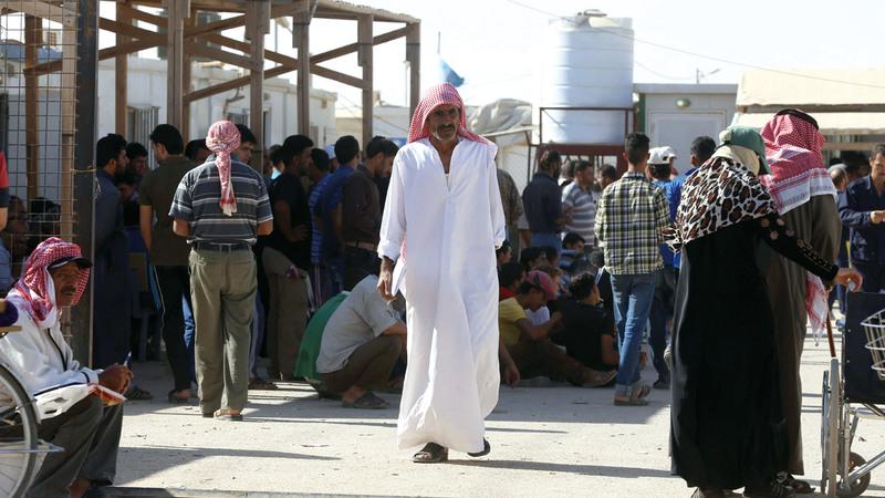 لاجئون سوريون عائدون إلى بلادهم من مخيّم الزعتري  في شمال الأردن. أ.ب