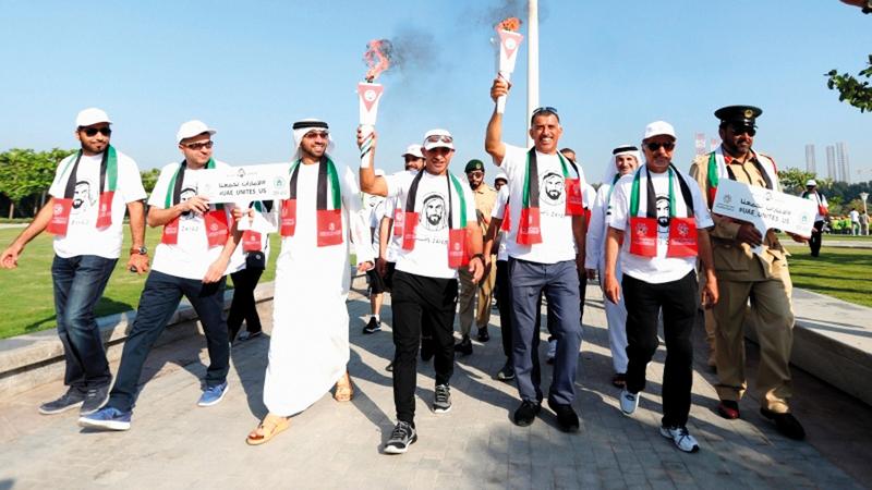 القرية العالمية التي تستضيف الحدث ستشهد مسيرة رياضية بـ «شعلة زايد». من المصدر