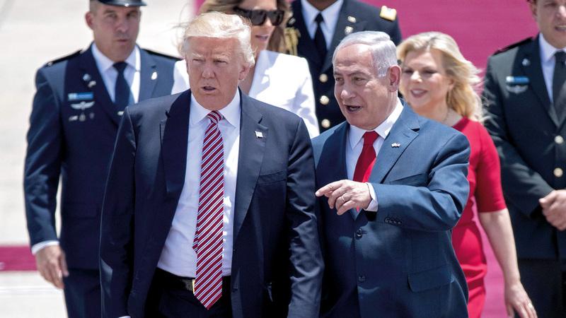 ترامب أثناء وصوله إلى مطار بن غوريون في آخر زيارة له إلى إسرائيل العام قبل الماضي.  أ.ف.ب