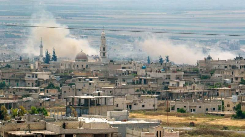 أعمدة الدخان تتصاعد جراء استمرار القصف بين الفرقاء.  أ.ف.ب